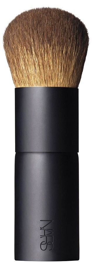 The NARS bronzing powder brush has soft, dense, natural hair to easily hold and apply product.