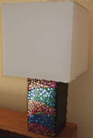 Create a groovy bedside lamp with some metallic confetti shapes, a Resene testpot and some Resene Multishield+ gloss.