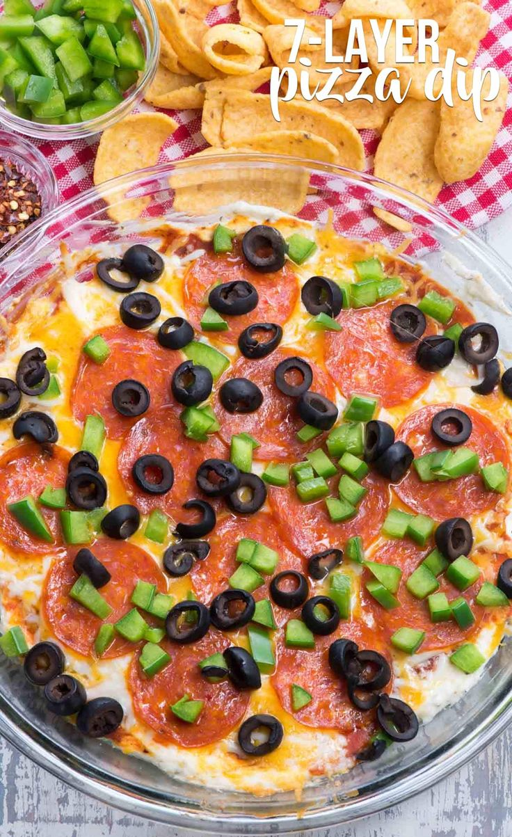 7 Layer Pizza Dip is an easy hot cheesy dip recipe that is even better than pizza!! There are 7 layers of cheese, sauce, and toppings that will be the HIT of your party. via @crazyforcrust