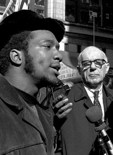 At a rally outside the U.S. Courthouse October 29, 1969, Dr. Benjamin Spock, background, listens to Fred Hampton, chairman of the Illinois Black Panther party speak at a protest against the trial of eight persons accused of conspiracy to cause a riot during the Democratic National Convention in 1968. (AP/stf)