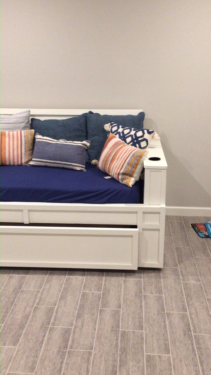 A MASSIVE trundle day bed custom made to fit into this