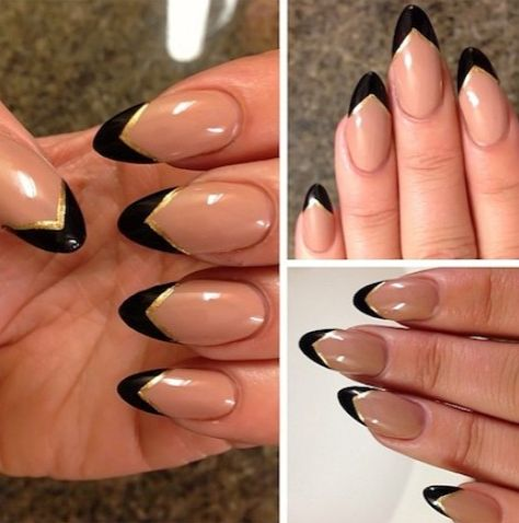 Nude stiletto nails with black with gold trim at the top