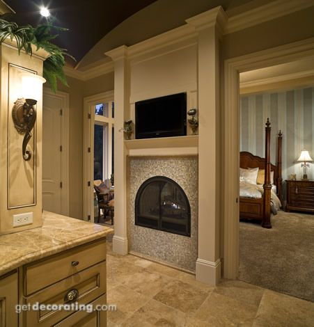 Fireplace between bedroom and bathroom