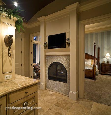 Fireplace between bedroom and bathroom