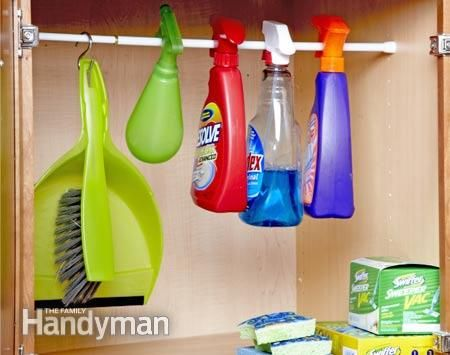 Keep your spray bottles in line: Hang spray bottles from a rod to keep them upright. http://www.familyhandyman.com/storage-organization/easy-organization/view-all