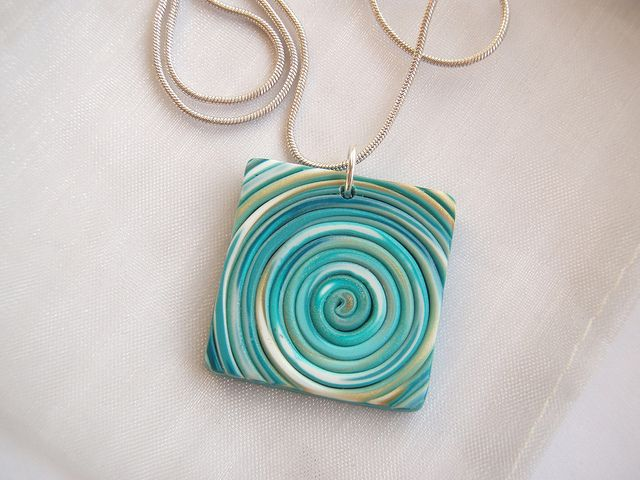 Really cool and simple polymer clay pendant by Di Keeble. Made from extruded gold and turquoise clay.