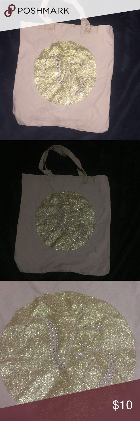 NAME YOUR PRICE! Victoria's Secret glitter tote Has glitter circle that has rhinestones spelling VS. tan and gold tote bag Victoria's Secret Bags Totes