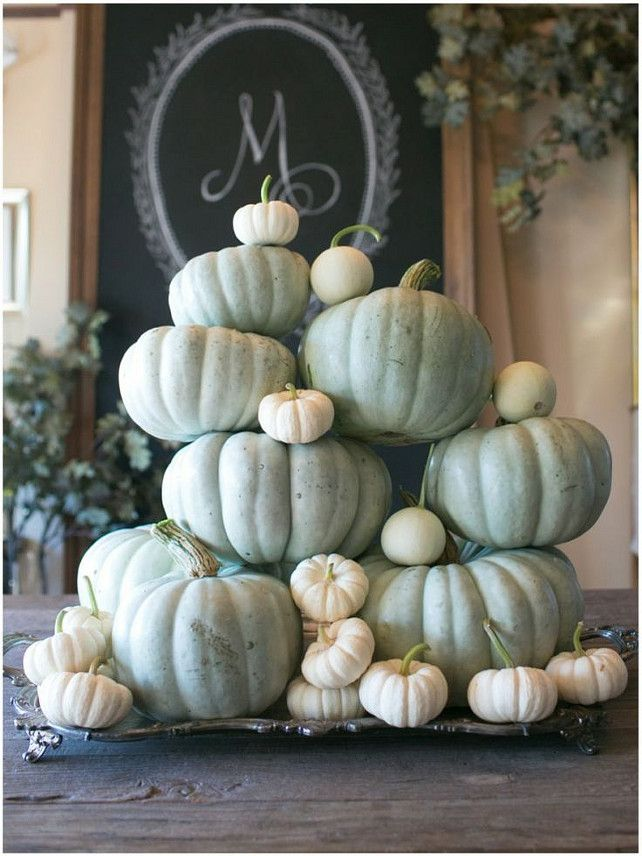 Pile on the white and grey pumpkins for texture and visual interest. (Via Sinclair and Moore)