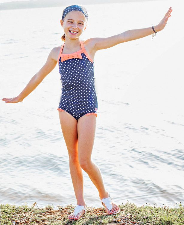 55874bcc11 Navy Polka Halter One Piece - RuffleButts.com Swim 19 is here! Your cutie  will stand out in this retro inspired one piece! The Navy and coral  complement ...