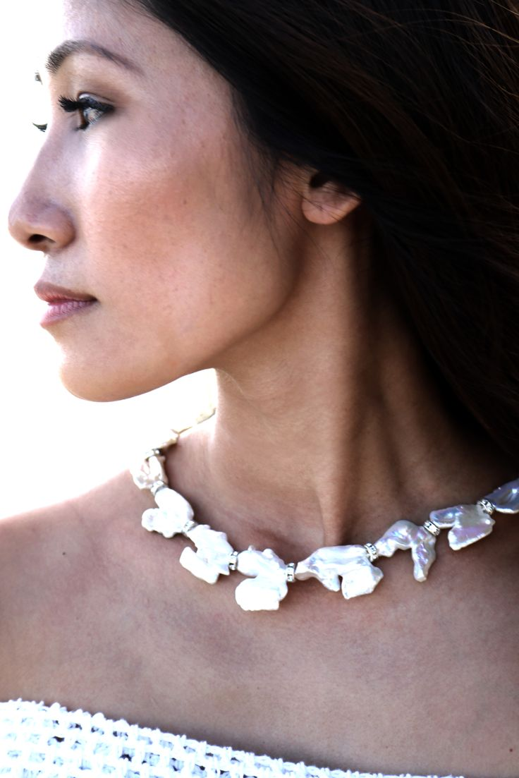 Abstract pearl necklace with crystals - each piece is unique and stunning.  Quite the statement piece! $1,100 USD and available soon on our website.