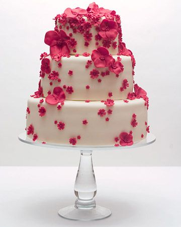 fuchsia flowers cascading down a cake