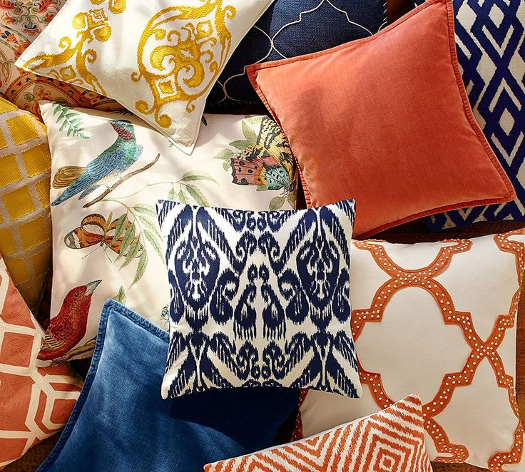 Bright and bold blue and orange pillows are the perfect way to makeover your home for the new year!