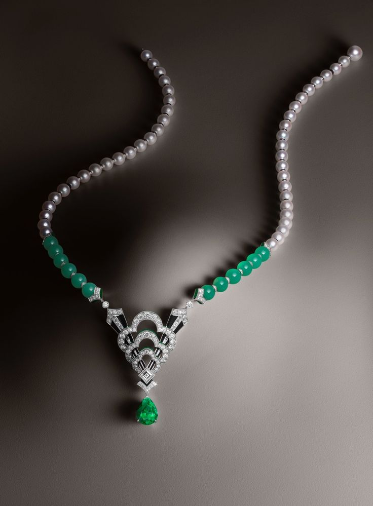 A 7.55 carat tsavorite garnet is set in Louis Vuitton's one of a kind Conquêtes necklace that also features chrysoprase, onyx, lacquer and diamonds.