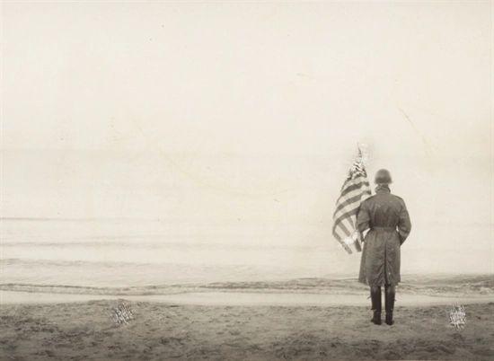 Robert Capa. Normandy June 1944. A Catholic Priest