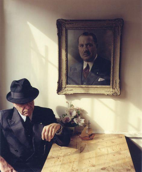 Leonard Cohen beneath a portrait of his father, Nathan Cohen | Tina Tyrell