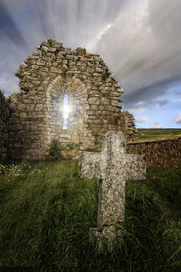 The cemetery at Fanore, County Clare, Ireland. The light was spectacular. There are remains of an old church in which some people are buried. The wall of the church acted as a shield for the sun rays, with an amazing effect.