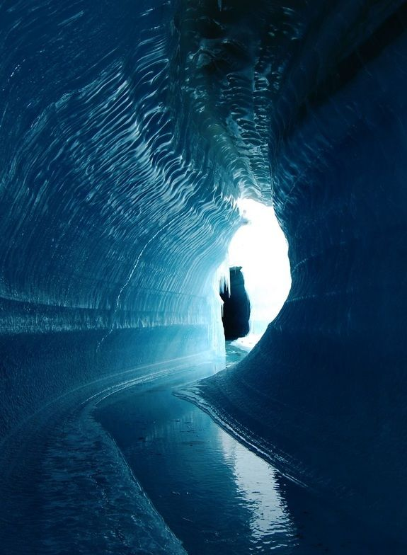 An ice cave or englacial melt channel. This ice cave was formed by meltwater flowing within the glacier ice. Belcher Glacier, Devon Island, Nunavut, Canada
