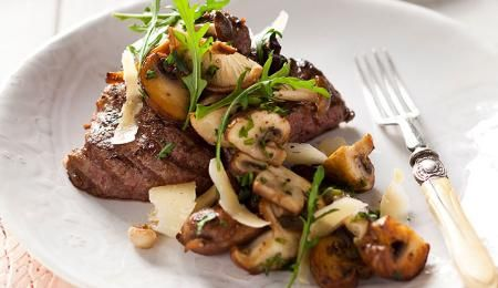 Seared pepper and lemon crusted ostrich fillets with sauteed wild mushrooms. Ostrich meat tastes very similar to beef but is a healthy alternative as it is low in fat and cholesterol. #recipe #PnP #healthy2015