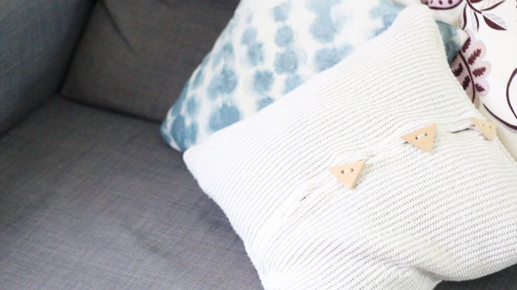 Winter white pillow from jumper with knob.