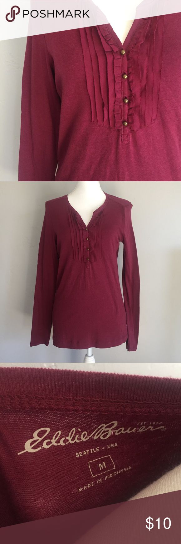 Eddie Bauer long sleeve Henley NWT long sleeved Henley from Eddie Bauer. Color is called wine. Ruffle features and four buttons down neckline. Measures approx 26 inches in length and 18 inches across the bust. Eddie Bauer Tops Tees - Long Sleeve