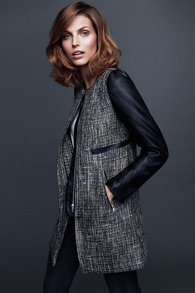 Black and white textured coat with contrasting leather sleeves. #WARMINHM