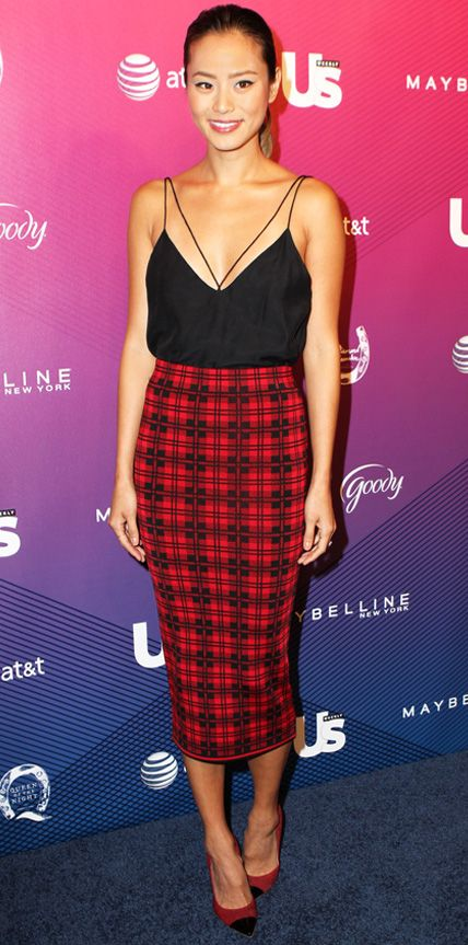 Jamie Chung hit a red carpet event in an alluring color palette of red and black with a sexy black cami, a printed mid-length pencil skirt and black-capped red Jerome C. Rousseau pumps.