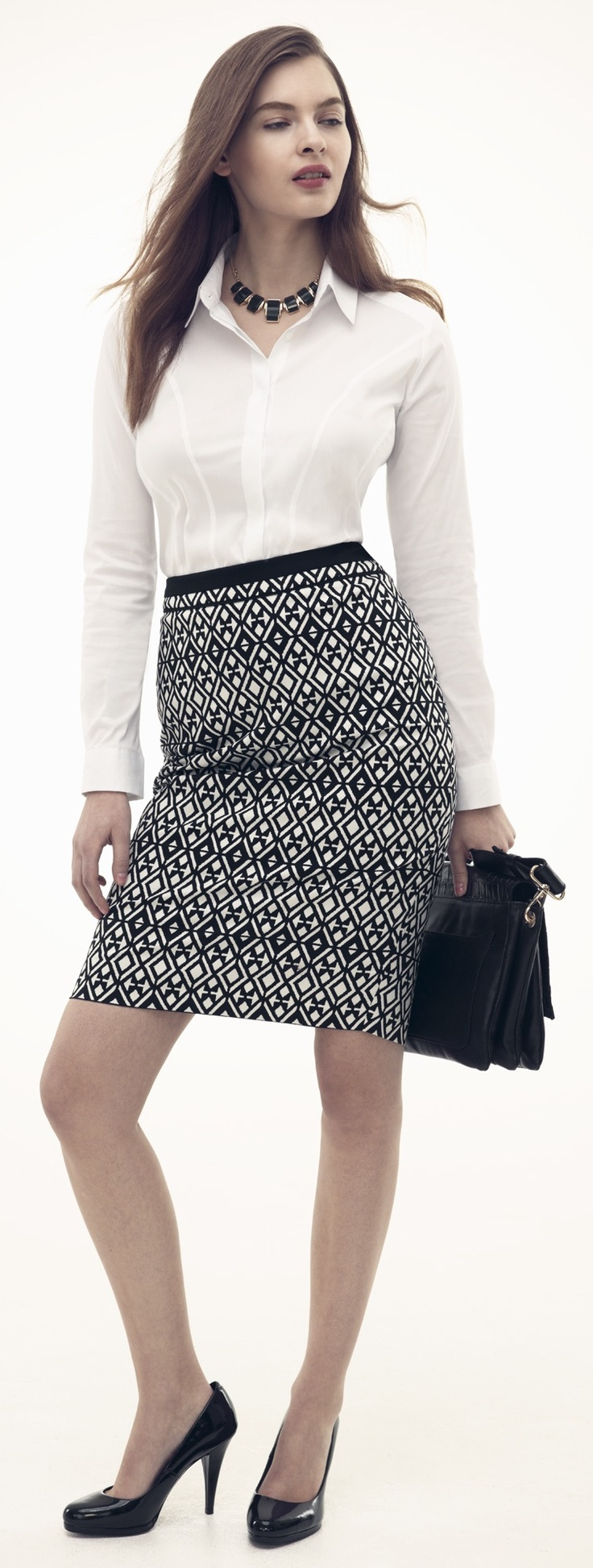Try Something A Little Different Next Time You Go Into Work With White Blouse And Tribal Print Skirt