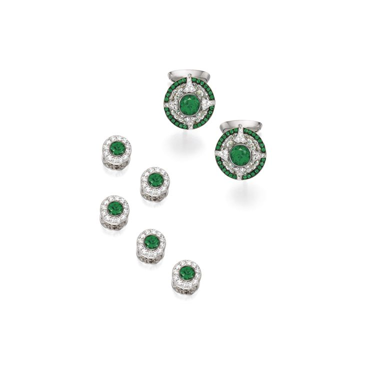Emerald and Diamond Dress Set, Carnet Comprising: pair of cufflinks, each designed as a single-cut diamond concave disc with circular-cut emerald border, centring upon a collet-set emerald, to the opposing similarly set bar; and five shirt studs, each set with a circular-cut emerald to the single-cut diamond surround; the emeralds and diamonds weighing approximately 3.00 and 2.50 carats in total respectively, mounted in 18 karat white gold, one cufflink and all studs signed Carnet, case…