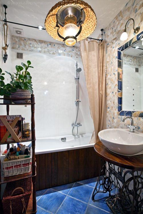 old sewing machine repurposed as a bathroom vanity + basket light.