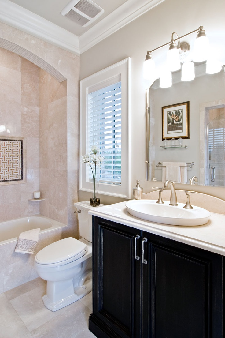 112 best bathroom ideas images on pinterest bathroom ideas room contrasting the light and airy floor and wall tiles this full bathroom s dark wood vanity stands out and gives the room some added character