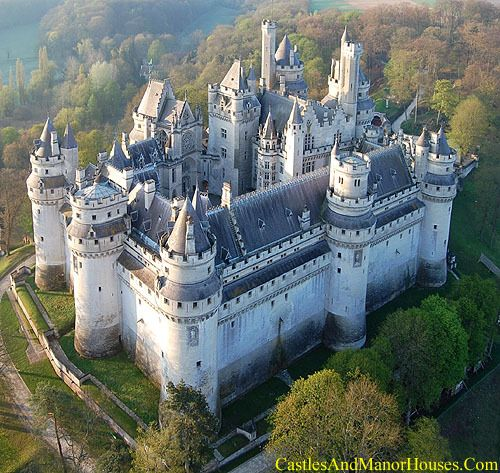 The Château de Pierrefonds,  Pierrefonds, Oise département, Picardy, France...    www.castlesandmanorhouses.com   ...    The Château is on the southeast edge of the Forest of Compiègne, north east of Paris, between Villers-Cotterêts and Compiègne. The Château still features most of the characteristics of defensive military architecture from the Middle Ages, though it underwent major restoration in the 19th century.