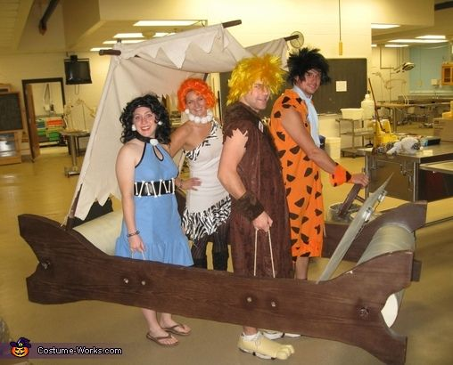 Jess: Here is the Flintstone family including me, Dave, Sarah and Erich. We are all vet students. My family made the car, so I brought it to school for Halloween festivities.