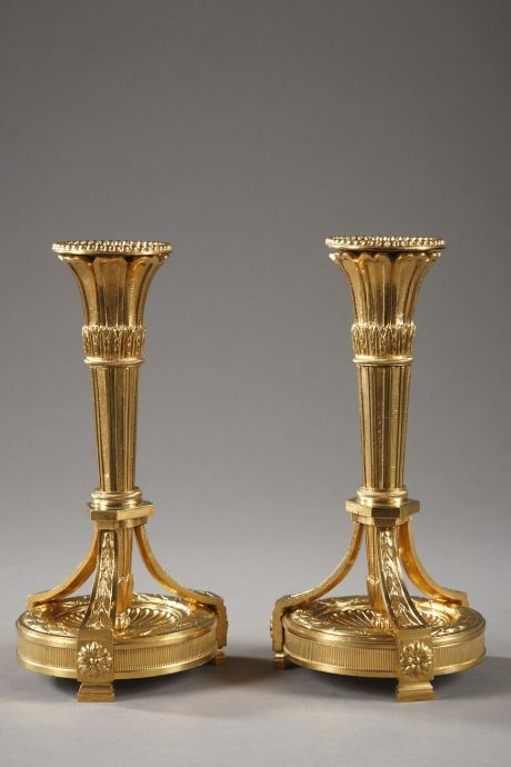 Pair of gilt bronze Louis XVI style candlesticks
