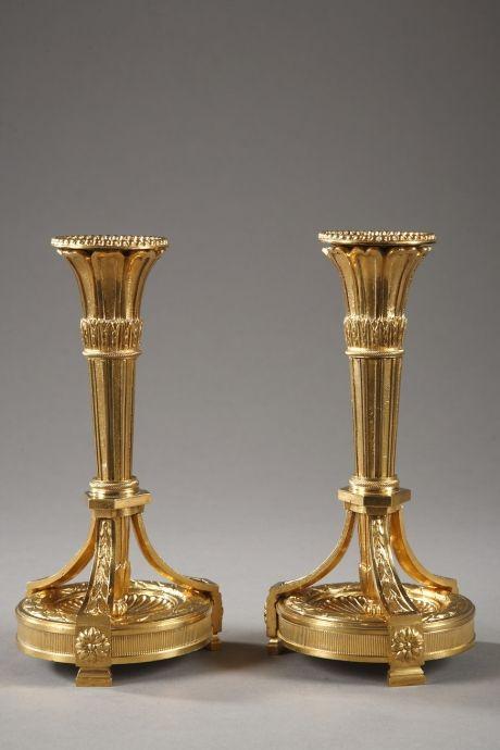 Pair of gilt bronze Louis XVI style candlesticks