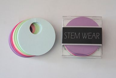 STEM WEAR ™ Set of 40 colorful disposable paper tags. Write your name or wine type on these handy disposable wine glass tags. Great for parties, tasting events, or any occasion in which glasses could easily be confused.  Great for both wine and martini glasses