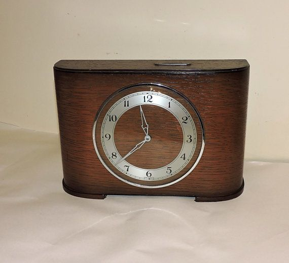 A desk mantel clock made in England in full working order. The clock hasnt been marked by any maker.  The item has been used and has some general sings