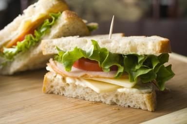 Turkey sandwich with cheese, lettuce, tomato and mayonnaise - Barry Wong/The Image Bank/Getty Images