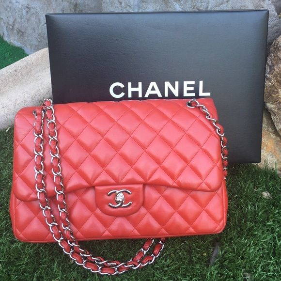 CHANEL Jumbo Flap gorgeous red bag♥️ ♥️Authentic CHANEL Jumbo Flap red gorgeous bag so beautiful on tiny worn in 4 corner of the bag shown on pictures 3 overall is in great condition in silver chain straps beautiful soft leather sell it in good price all of the request only serious buyer pleasecome with dust bag and original box♥️ CHANEL Bags