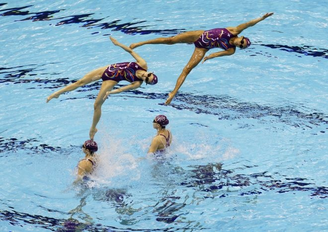 The Chinese women's synchronized team rehearse at the Aquatics Center at the Olympic Park ahead of the 2012 Summer Olympics, Tuesday, July 24, 2012, in London. Opening ceremonies for the 2012 London Olympics will be held Friday, July 27. (AP Photo/Lee Jin-man)