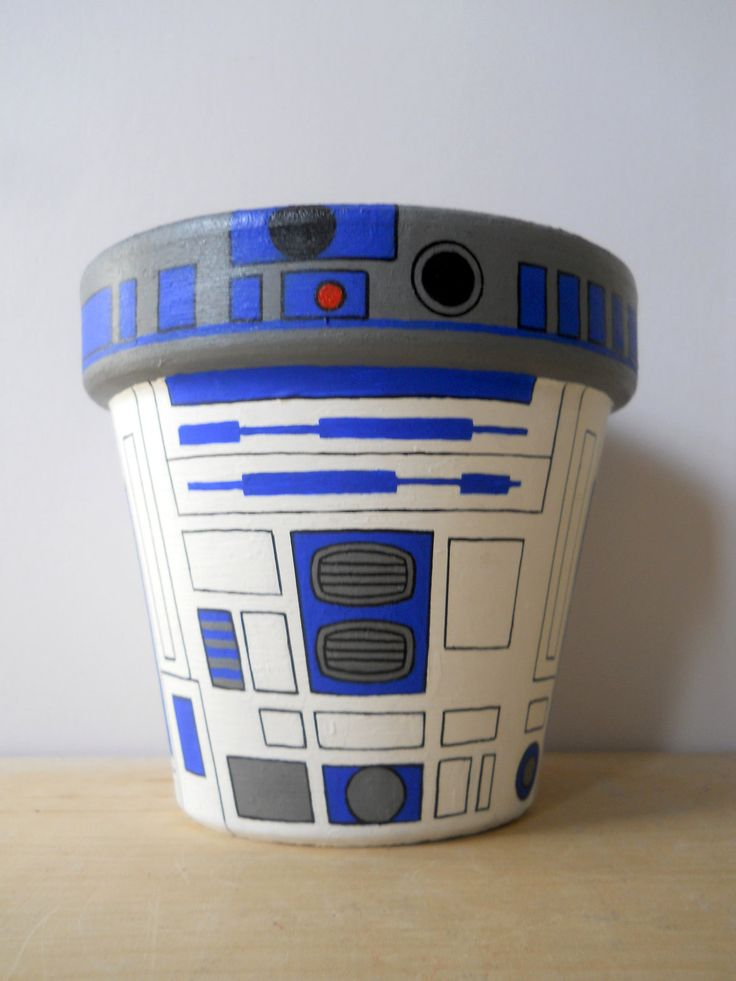 R2D2 Star Wars Droid Painted Flower Pot. I might actually attempt to garden if I had a flower pot like this.