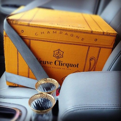The champagne deserves the font seat and a seat belt to keep it safe... Soon true, and why not put the flutes in the cup holder too.