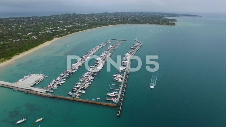 Static aerial shot of Blairgowrie Marina showing boat sailing along the - Stock Footage | by gregbrave