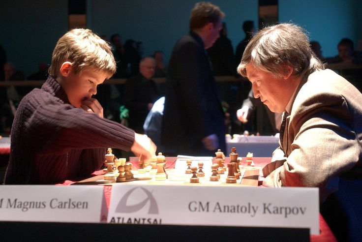 Magnus Carlsen –  Anatoli Karpov, Reykjavik Rapid 2004 http://netkaup.is/2013/10/05/magnus-carlsen-reykjavik-rapid-2004/ Magnus Carlsen  33 Images of Magnus Carlsen's Path to Success In 2013, at the age of 22, Carlsen became 16th World Chess Champion. After becoming a world chess champion he was asked what would he prefer: being world's number 1 or having a world chess championship title? He shrugged his shoulders and said, both.  21.6. 2014 NCO eCommerce, www.netkaup.is