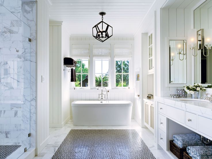 The retro, all-white bathroom is a relaxing spot.