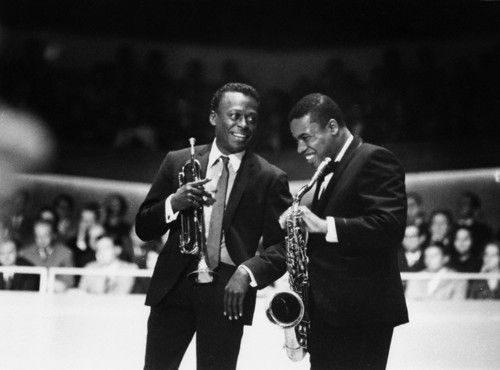 "Wayne Shorter.25 August.Born Today. On stage with Miles Davis. ""For me, the word 'jazz' means, 'I dare you.'"" —Wayne Shorter"