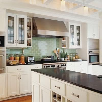 Blue-green subway tile, white cabinets, black countertops