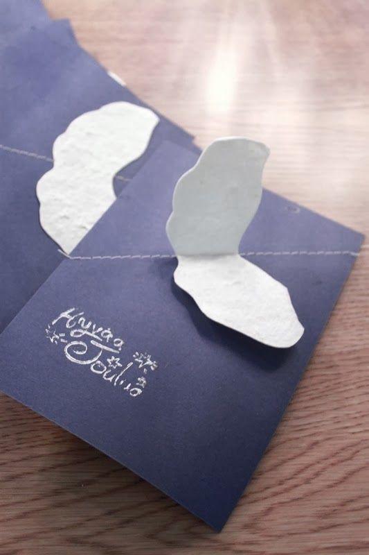enkelin siivet joulukortissa