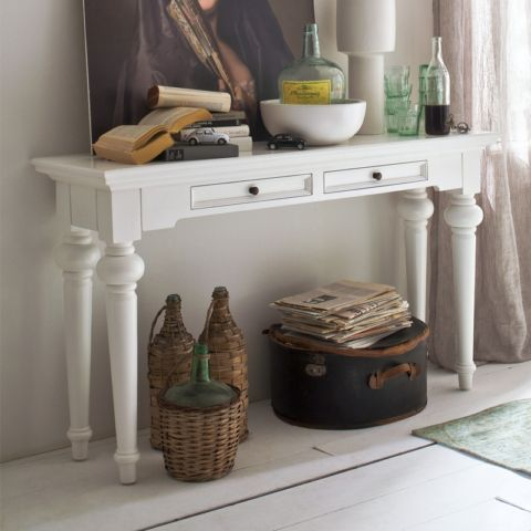 Once you have a console table in your home, you'll wonder how you ever managed without it. Not only does it provide space to showcase a vase, lamp or treasured ornament, but can also become that go-to place to keep everyday essentials, be it keys or a hallway notepad and pencil. And with double drawer space, it means clutter stays contained.