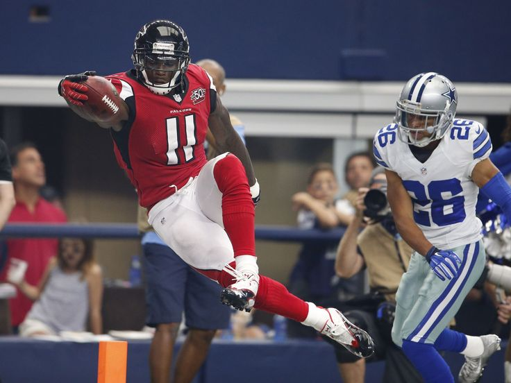 Atlanta Falcons receiver Julio Jones, left, dives for the pylon to score in the third quarter against Dallas Cowboys cornerback Tyler Patmon at AT&T Stadium.   Matthew Emmons, USA TODAY Sports