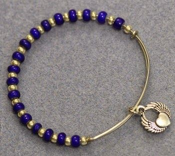DIY Adjustable Bangle Bracelet with Beads and  Charms, similar to Alex and Ani bracelets.  Learn to make your own wire bracelet the easy way! Free tutorial from Bead World.